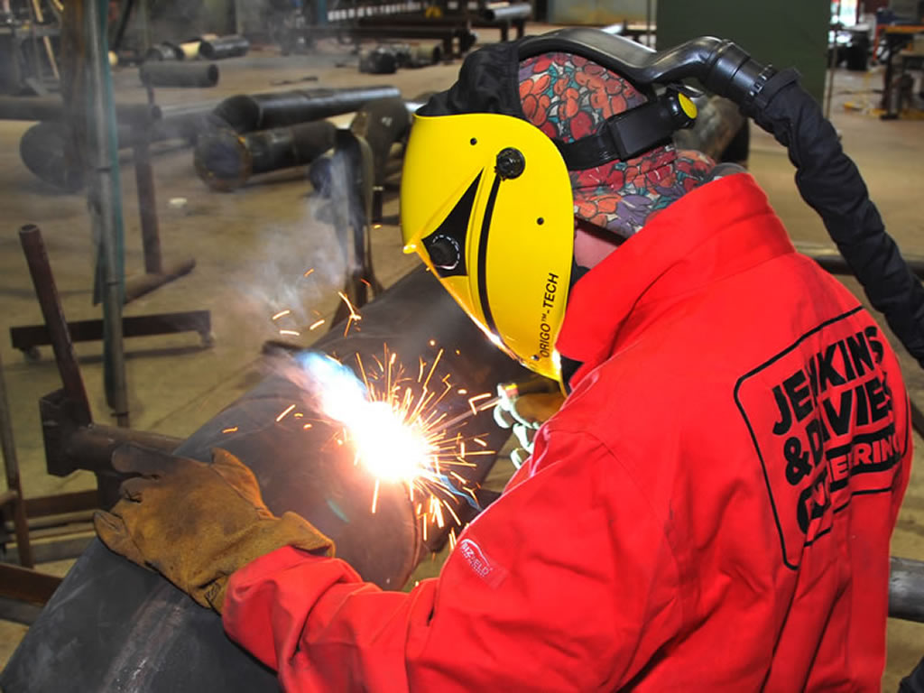 Fabrication welder working