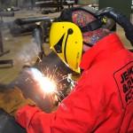 Fabrication welder working
